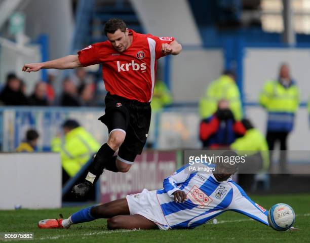 Huddersfield Town's Theo Robinson challenges Charlton Athletic's Frazer Richardson during the CocaCola League One match at the Galpharm Stadium...