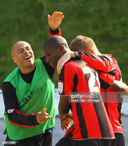 Huddersfield's Benik Afobe celebrates with team mates after scoring his sides second goal during the League One match at the Withdean Stadium Brighton