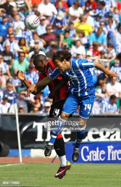Huddersfield's Benik Afobe in action against Brighton Hove Albion's Inigo Calderon during the League One match at the Withdean Stadium Brighton