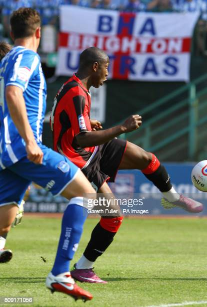 Huddersfield's Benik Afobe shoots and scores his sides second goal during the League One match at the Withdean Stadium Brighton