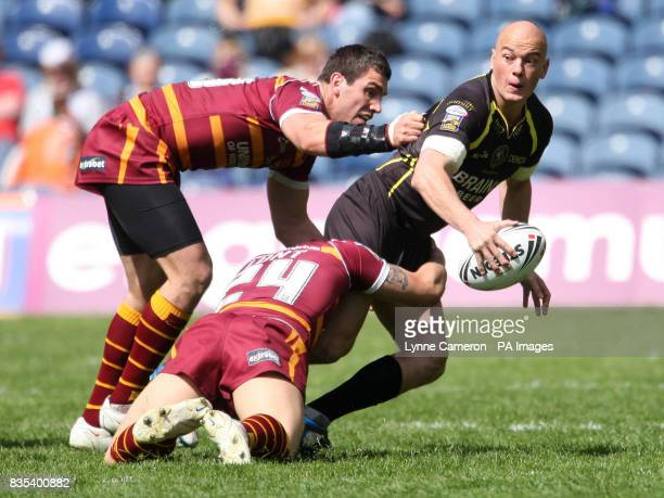 Huddersfield's Shaun Lunt and Celtic Crusaders' Jace Van Dijk during the engage Super League Magic Weekend match at Murrayfield Stadium