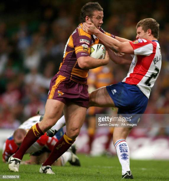 Huddersfield's Steve Snitch is tackled by Wakefield's Matt Blaymire during the Engage Super League match at the Millennium Stadium Cardiff