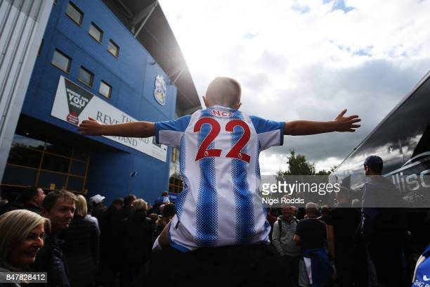 Huddersield Town fan enjoys the pre match atmosphere prior to the Premier League match between Huddersfield Town and Leicester City at John Smith's...