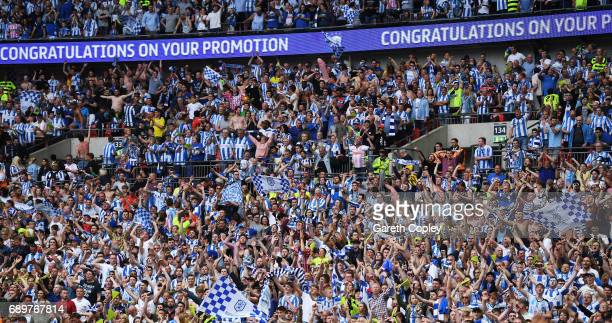 Huddersield Town fans celebrate after the Sky Bet Championship play off final between Huddersfield and Reading at Wembley Stadium on May 29 2017 in...