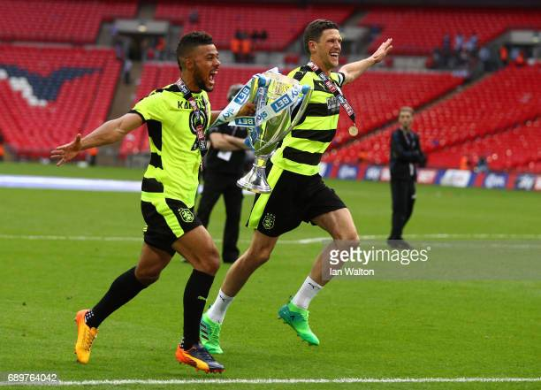 Huddersield Town players celebrates with The Championship play off trophy after the Sky Bet Championship play off final between Huddersfield and...