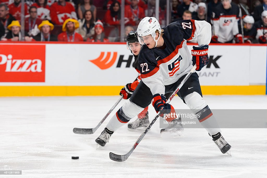 <a gi-track='captionPersonalityLinkClicked' href=/galleries/search?phrase=Hudson+Fasching&family=editorial&specificpeople=9771190 ng-click='$event.stopPropagation()'>Hudson Fasching</a> #22 of Team United States looks to play the puck in a preliminary round game during the 2015 IIHF World Junior Hockey Championships against Team Canada at the Bell Centre on December 31, 2014 in Montreal, Quebec, Canada. Team Canada defeated Team United States 5-3.