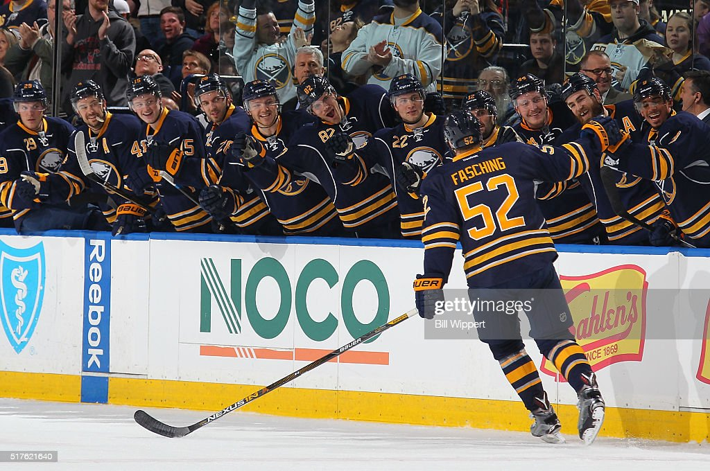 <a gi-track='captionPersonalityLinkClicked' href=/galleries/search?phrase=Hudson+Fasching&family=editorial&specificpeople=9771190 ng-click='$event.stopPropagation()'>Hudson Fasching</a> #52 of the Buffalo Sabres celebrates his first NHL goal with the bench during their NHL game against the Winnipeg Jets on March 26, 2016 at the First Niagara Center in Buffalo, New York.