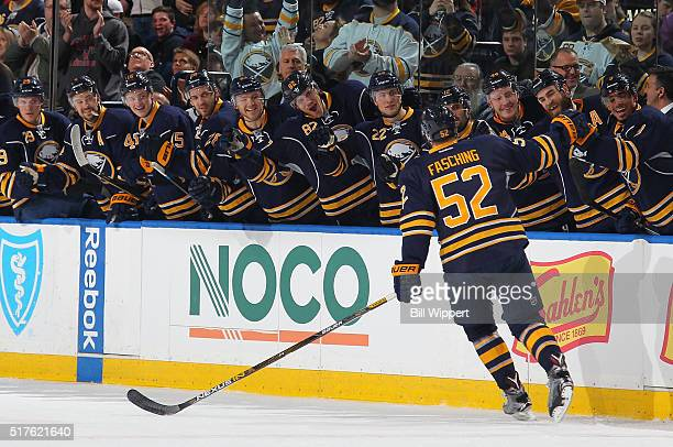 Hudson Fasching of the Buffalo Sabres celebrates his first NHL goal with the bench during their NHL game against the Winnipeg Jets on March 26 2016...