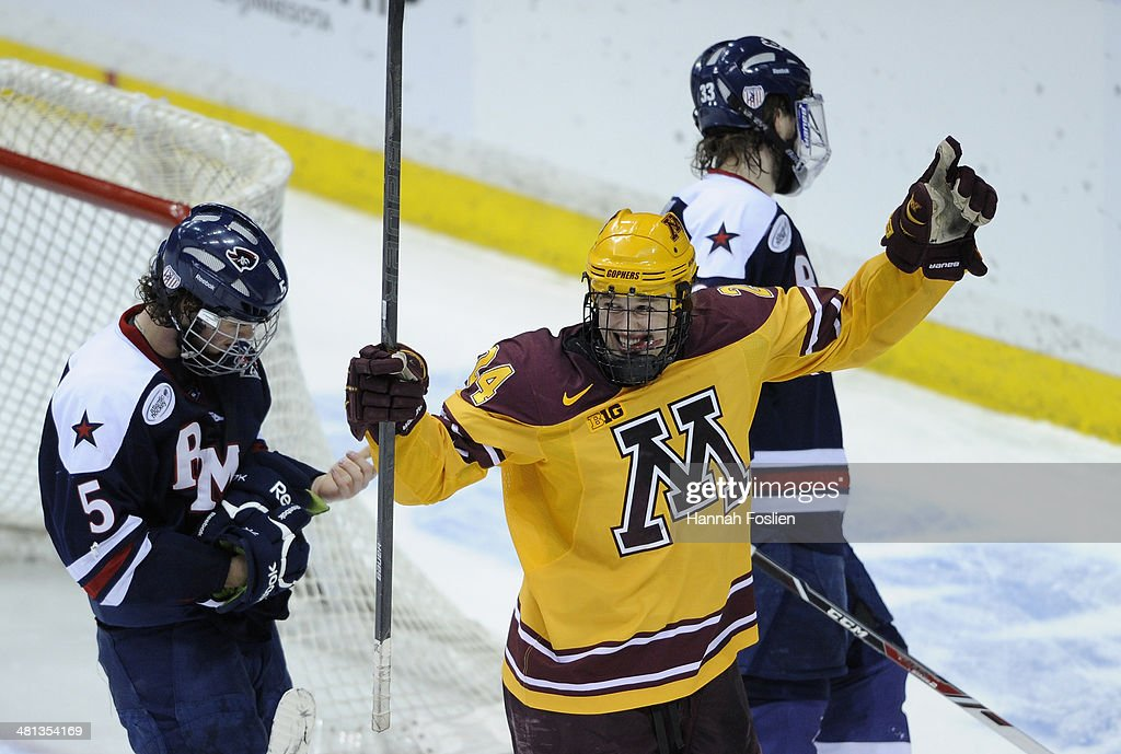 <a gi-track='captionPersonalityLinkClicked' href=/galleries/search?phrase=Hudson+Fasching&family=editorial&specificpeople=9771190 ng-click='$event.stopPropagation()'>Hudson Fasching</a> #24 of the Minnesota Golden Gophers celebrates a goal as Evan Moore #5 and Andrew Blazek #33 of the Robert Morris Colonials look on during the third period of the West Regional game of the 2014 NCAA Division I Men's Ice Hockey Championship game on March 29, 2014 at Xcel Energy Center in St Paul, Minnesota. The Minnesota Golden Gophers defeated the Robert Morris Colonials 7-3.