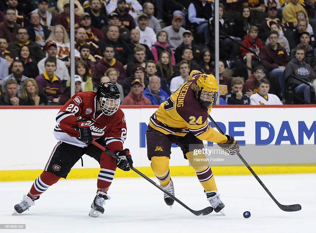 <a gi-track='captionPersonalityLinkClicked' href=/galleries/search?phrase=Hudson+Fasching&family=editorial&specificpeople=9771190 ng-click='$event.stopPropagation()'>Hudson Fasching</a> #24 of the Minnesota Golden Gophers controls the puck against Andrew Prochno #28 of the St. Cloud State Huskies during the first period of the final game in the West Regional of the 2014 NCAA Division I Men's Ice Hockey Championship on March 30, 2014 at Xcel Energy Center in St Paul, Minnesota.
