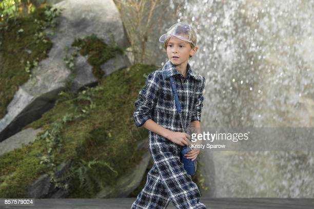 Hudson Kroening walks the runway during the Chanel show as part of Paris Fashion Week Womenswear Spring/Summer 2018 on October 3 2017 in Paris France