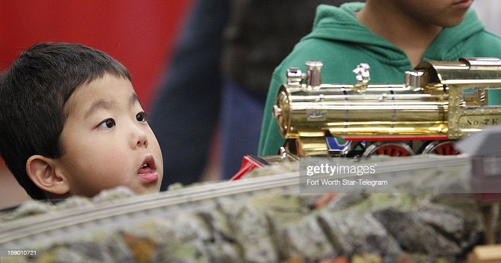 Hudson Skaggs, 5, of Willow Park, Texas, watches as a locomotive approaches at the World's Greatest Hobby on Tour train show at Will Rogers Memorial Center in Fort Worth, Texas, Saturday, January 5, 2013.