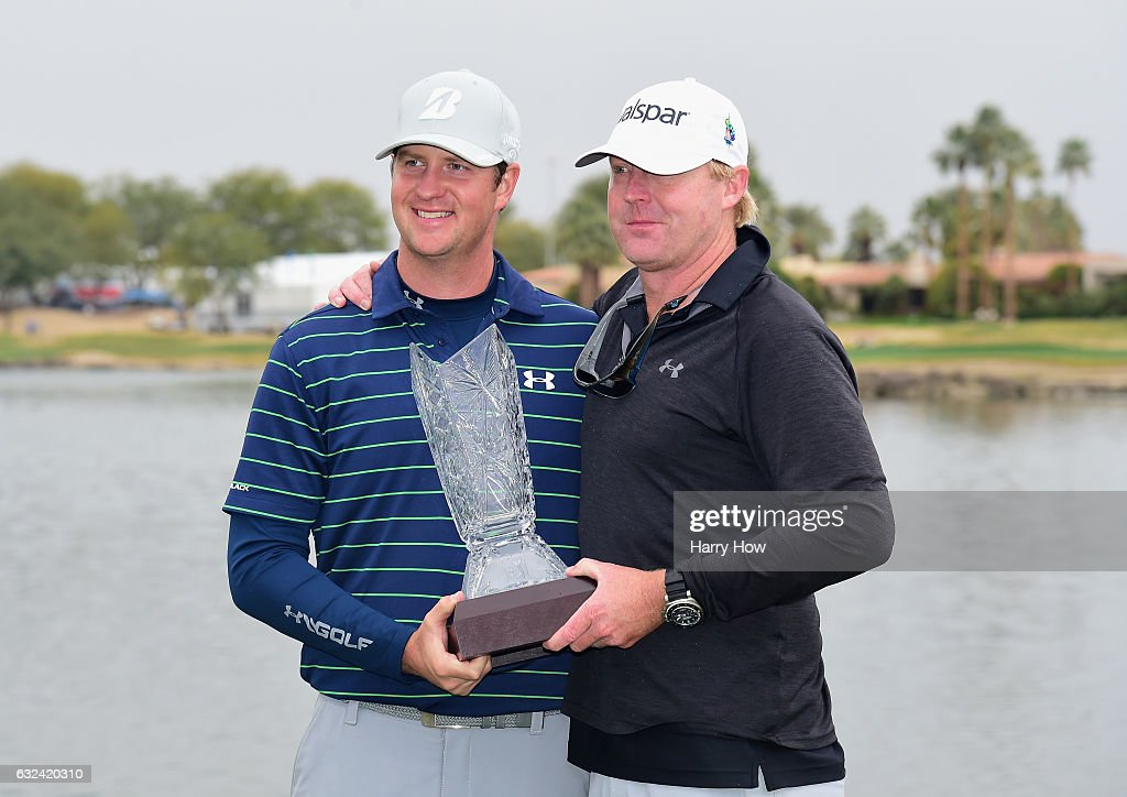 Hudson Swafford and his caddie D.J. Nelson pose with the trophy during the final round of the CareerBuilder Challenge in partnership with The Clinton Foundation at the TPC Stadium Course at PGA West on January 22, 2017 in La Quinta, California.