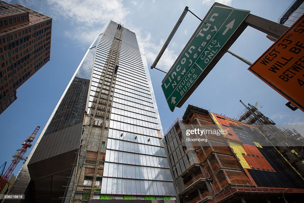 10 Hudson Yards, center, home to Coach Inc.'s new offices, stands in New York, U.S., on Tuesday, May 31, 2016. The first skyscraper at Related Cos.'s $25 billion Hudson Yards project opened Tuesday after three and a half years of construction, bringing office workers to a once-desolate area of Manhattan's far west side that's now transforming into a new business enclave. Photographer: Michael Nagle/Bloomberg via Getty Images