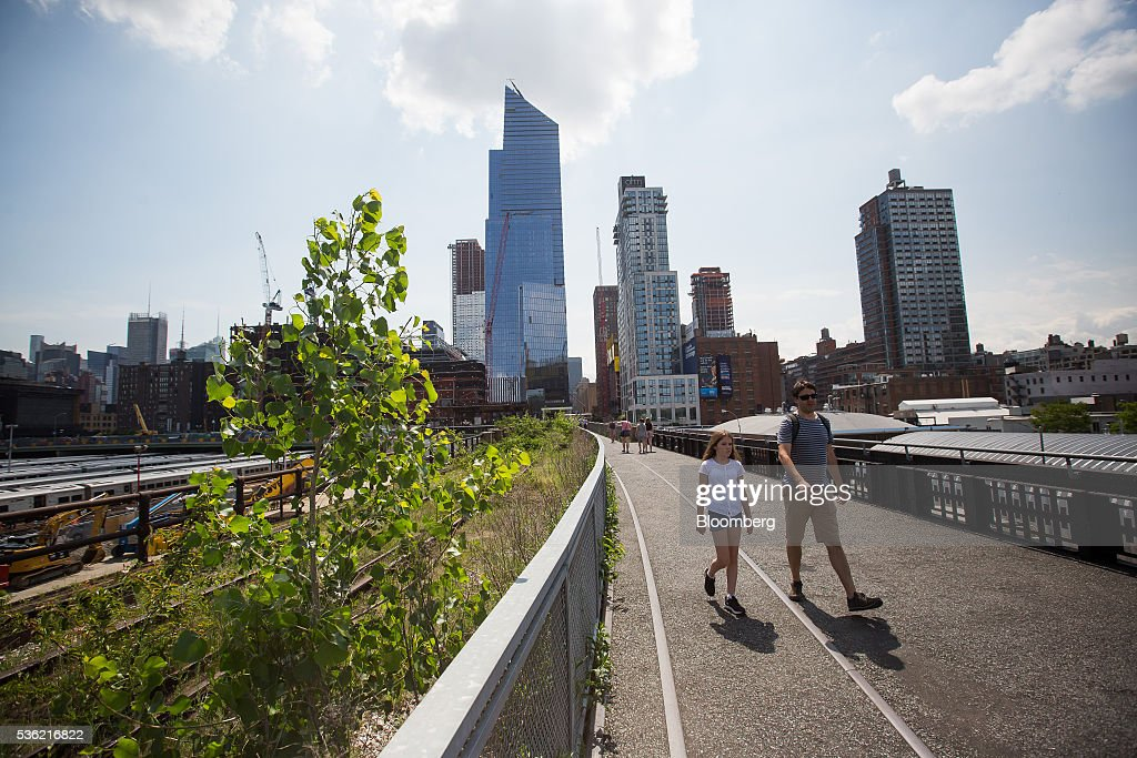 10 Hudson Yards, center left, home to Coach Inc.'s new offices, stands in New York, U.S., on Tuesday, May 31, 2016. The first skyscraper at Related Cos.'s $25 billion Hudson Yards project opened Tuesday after three and a half years of construction, bringing office workers to a once-desolate area of Manhattan's far west side that's now transforming into a new business enclave. Photographer: Michael Nagle/Bloomberg via Getty Images