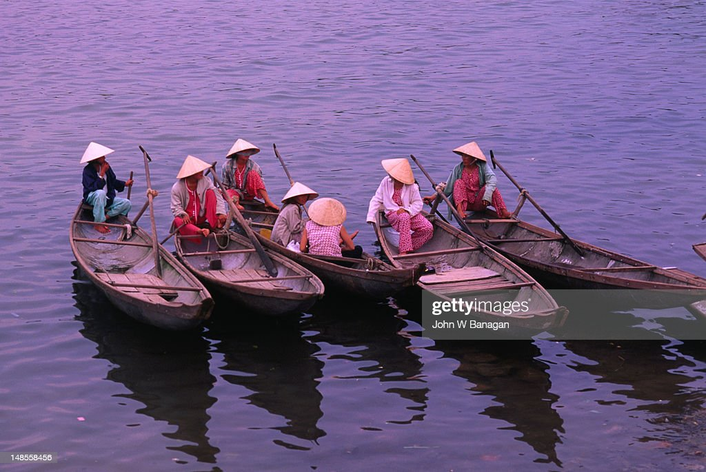 Hue ferry boat women wait for passengers on Perfume River. : Stock Photo