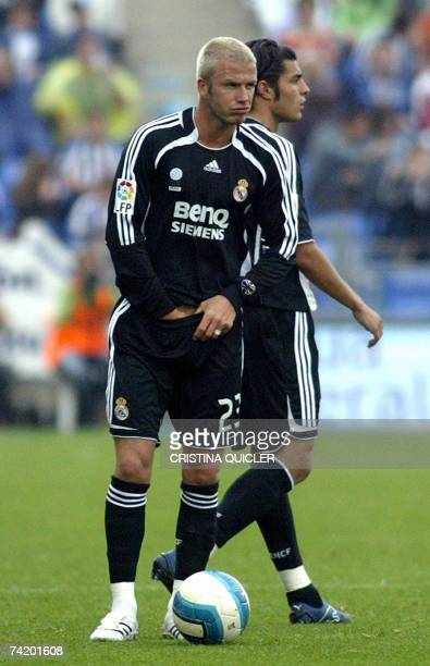 Real Madrid's British David Beckham holds his crutch during a Spanish league football match against Recreativo de Huelva at the Nuevo Colombino...