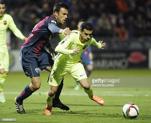 Huesca's defender Carlos David Moreno vies with Barcelona's forward Pedro Rodriguez during the Spanish Copa del Rey round of 32 first leg football...