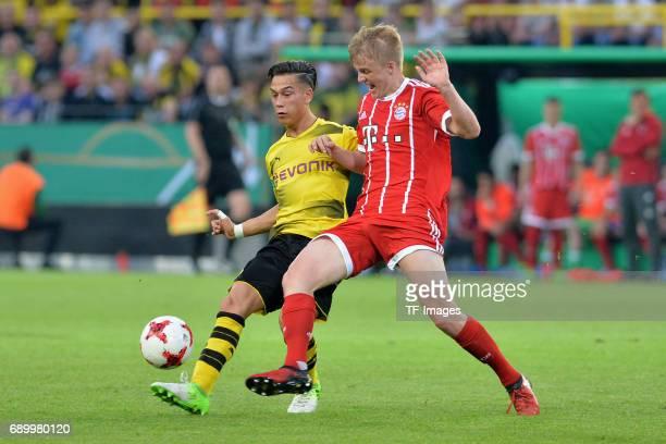Hueseyin Bulut of Dortmund and Felix Goetze of Munich battle for the ball during the U19 German Championship Final match between U19 Borussia...