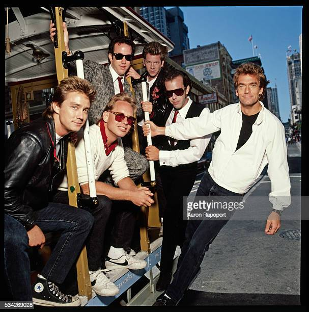 Huey Lewis and the News ride the San Francisco cable car for Rolling Stone Magazine