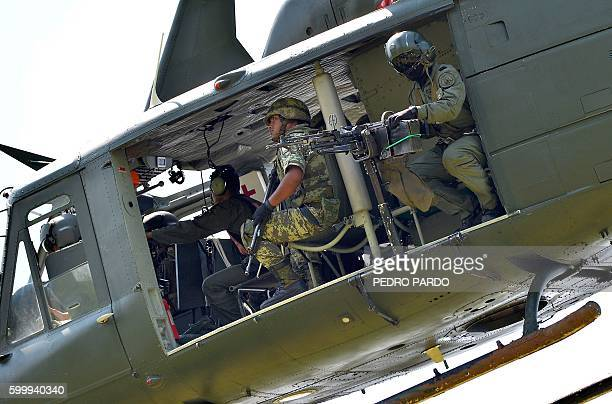 A Huey UH1 Mexican army helicopter overflies the area on September 7 2016 in El Chauz Michoacan State Mexico near the place where a police helicopter...
