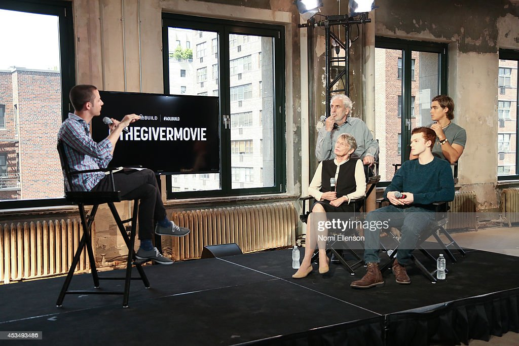 Huffington Post moderator Matthew Jacobs, author Louis Lowry, actor Cameron Monaghan director Phillip Noyce, and actor Brenton Thwaites attend AOL's Build Speaker Series Presents: 'The Giver' Author, Director & Cast at AOL Studios In New York on August 11, 2014 in New York City.