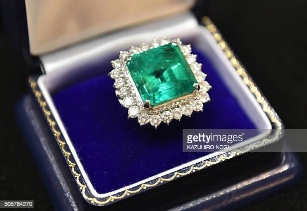 A huge 3529 ct emerald ring with diamonds by Japan's Daikokuya valued at 43000 yen is seen at the International Jewellery Fair in Tokyo on January 20...