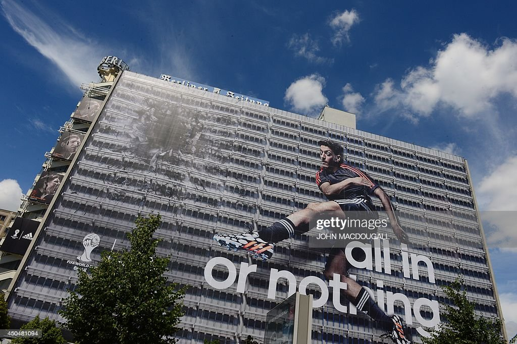 A huge advertising of German sportswear manufacturer Adidas showing German national player Mesut Oezil is seen on the building of the German...