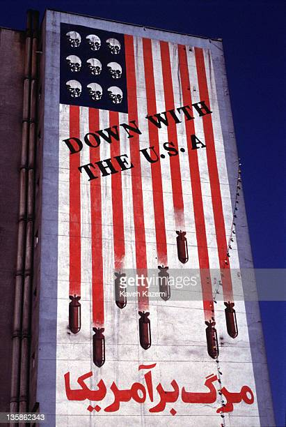 A huge antiUS mural on the side of a building in central Tehran 1st April 1997 The mural shows bombs attached to the stripes of the flag and skulls...