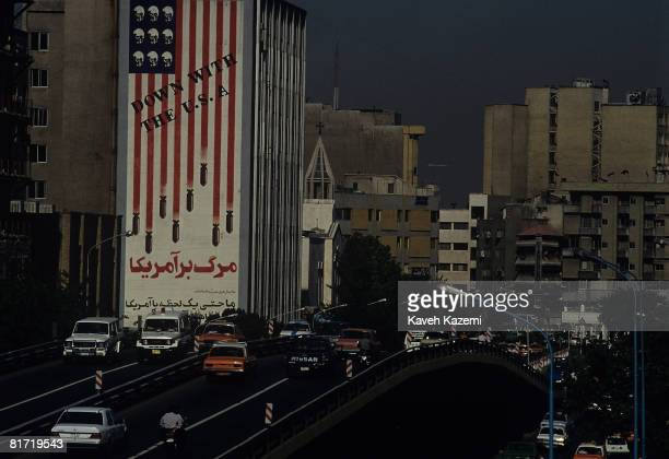 A huge antiUS mural on the side of a building in central Tehran April 1997 The mural shows bombs attached to the stripes of the flag and skulls in...