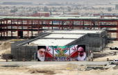 A huge banner bearing portraits of Iran's supreme leader Ayatollah Ali Khamenei and his predecessor the founder of the Islamic republic Ayatollah...