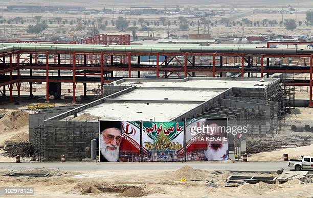 A huge banner bearing portraits of Iran's supreme leader Ayatollah Ali Khamenei and his predecessor the founder of the Islamic republic Ayatollah...