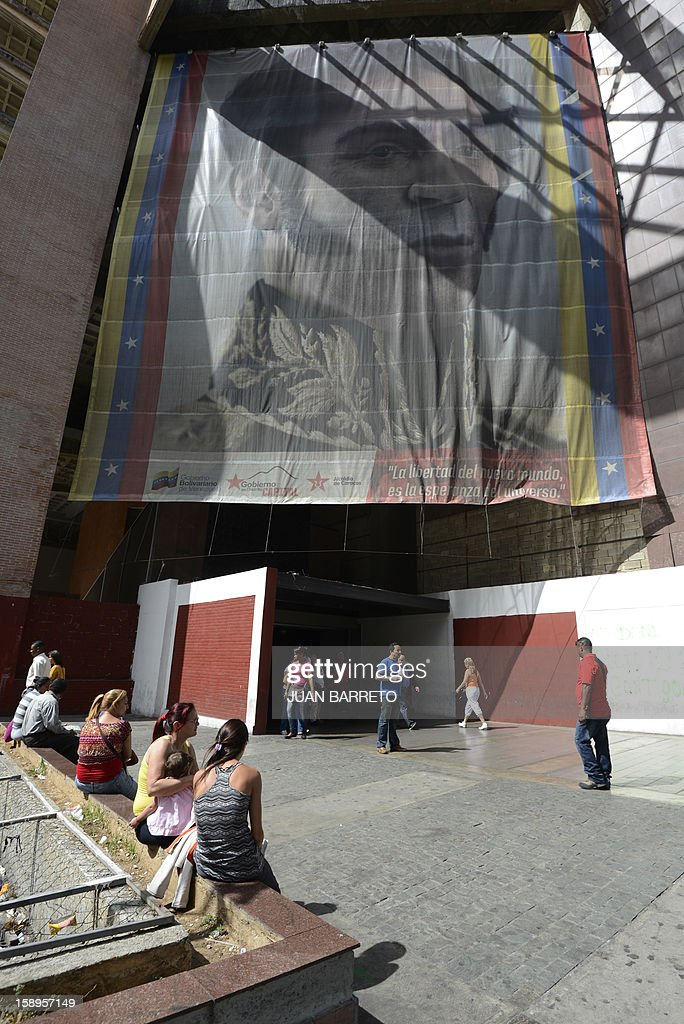 A huge banner Latin American independence hero Simon Bolivar is seen in Caracas on January 4, 2013. AFP PHOTO/Juan BARRETO