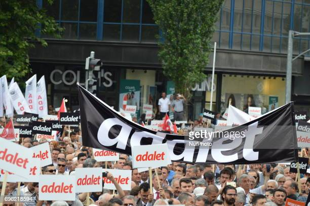 A huge banner that reads 'Justice' in Turkish is seen during the 'Justice March' to protest against the Turkish government held by the main...