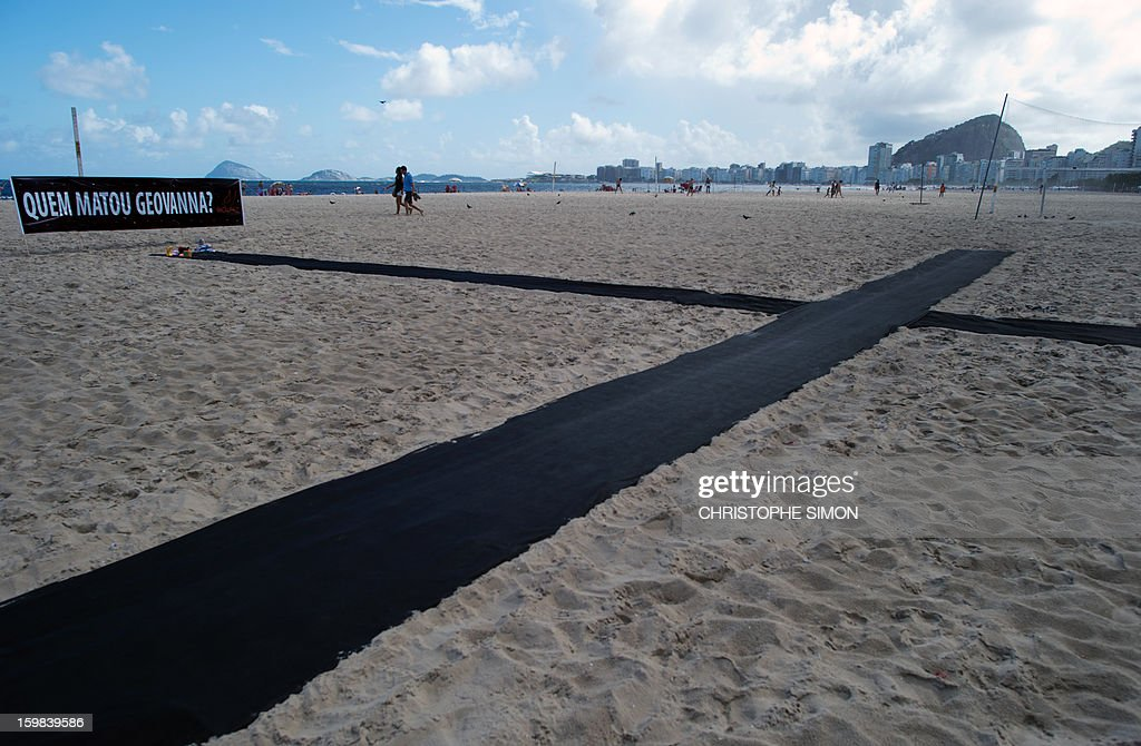 A huge black cross was displayed for Geovanna Vitoria de Barros, 1, who was shot dead in the family car last Friday 18 during a robbery attack in Baixo Fluminense, on January 21, 2013, on Copacabana beach in Rio de Janeiro.