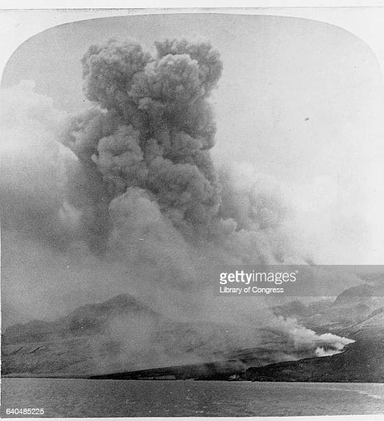 Huge clouds of ash pour from the Mount Pelee volcano during its 1902 eruption Martinique