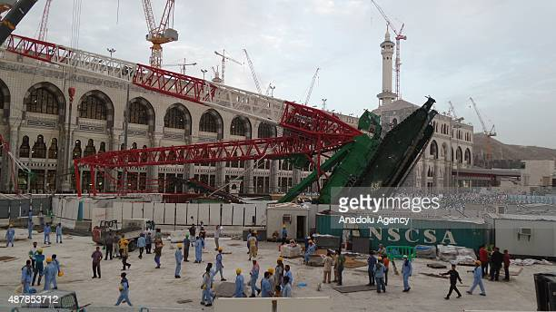 A huge construction crane buffeted by strong winds collapsed and crashed through the roof of the Grand Mosque which surrounds the Kaaba Islam's...