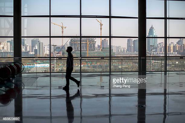 A huge construction site outside the french window of Beijing International Conference Center In 2015 China will take measures to counter housing...
