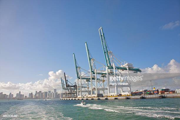 Huge container cranes near waters of Biscayne Bay
