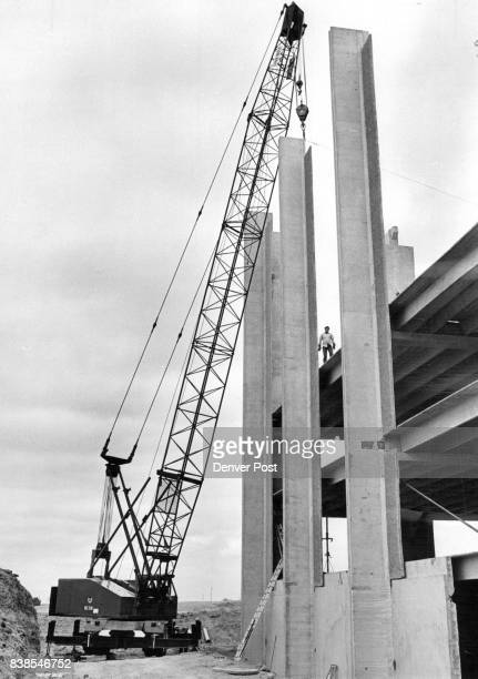 A huge crane delicately moves into final position in its prebuilt foundation resting place one of the 36ton precast and prestressed concrete...