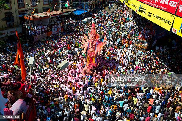 A huge crowd follows the Idol of lord Ganesha when it is taken for immersion There is a lot of fervour surrounding Ganapati festival Ganesha...