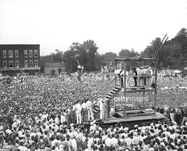 A huge crowd of over 15 000 people gathers around a scaffold to witness the public hanging of 22year old Rainey Bethea August 14 1936 in Owensboro...