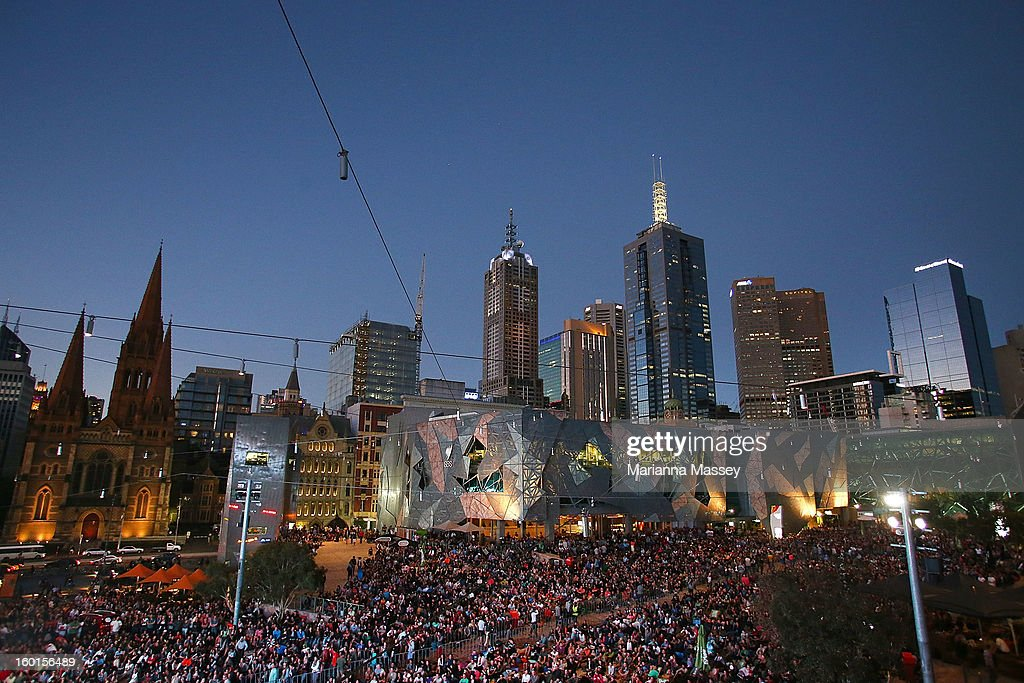 Huge crowds gather at Federation Square to watch the men's final match during day fourteen of the 2013 Australian Open at Melbourne Park on January 27, 2013 in Melbourne, Australia.