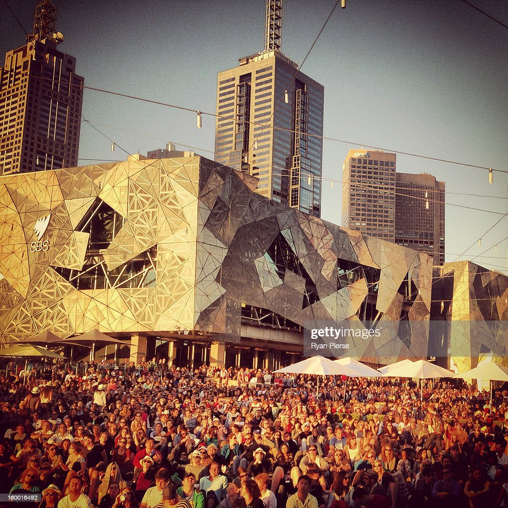Huge crowds gather at Federation Square to watch the third round match between Bernard Tomic of Australia and Roger Federer of Switzerland during day six of the 2013 Australian Open on January 19, 2013 in Melbourne, Australia.