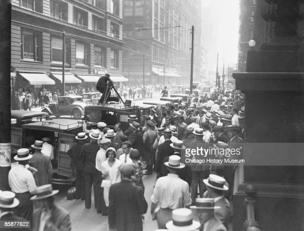 Huge crowds gather outside the Federal Building in Chicago to get a glimpse of notorious gangster Al Capone during his trial for tax evasion 1931...