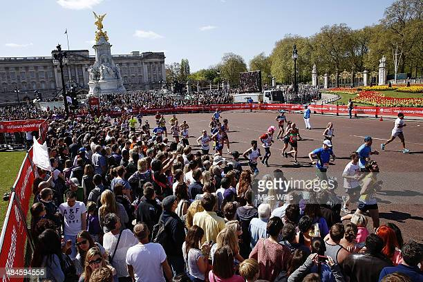 Huge crowds watch the runners as they pass Buckingham Palace during the Virgin London Marathon on April 13 2014 in London England