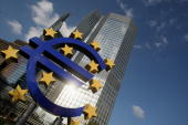 A huge euro logo stands in front of the headquarters of the European Central Bank on April 9 2009 in Frankfurt am Main Germany The city of Frankfurt...