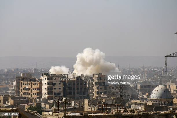 A huge explosion sends clouds into the air after Assad Regime's forces carried out air strikes over the deconflict zone Sakba district in the Eastern...