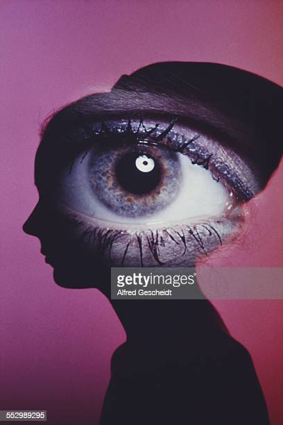 A huge eye superimposed over the silhouette of a young woman circa 1990