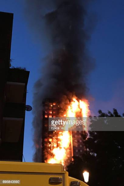 A huge fire engulfs the 24 storey Grenfell Tower in Latimer Road West London in the early hours of this morning on June 14 2017 in London England The...